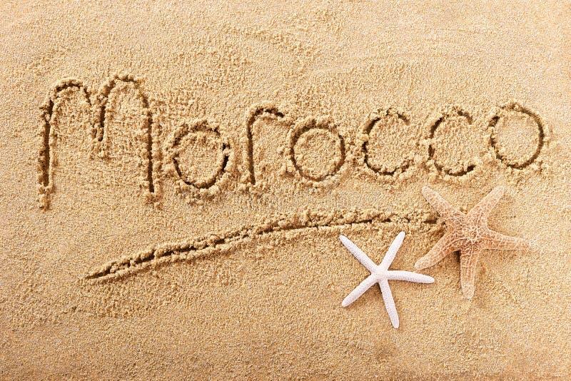 Morocco beach word writing message travel concept. Morocco beach word written in sand stock photography