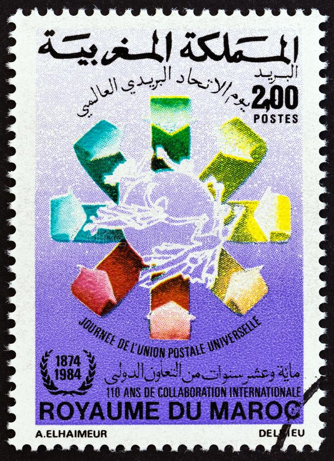 MOROCCO - CIRCA 1984: A stamp printed in Morocco issued for the Universal Postal Union Day shows emblem, circa 1984. royalty free stock photos