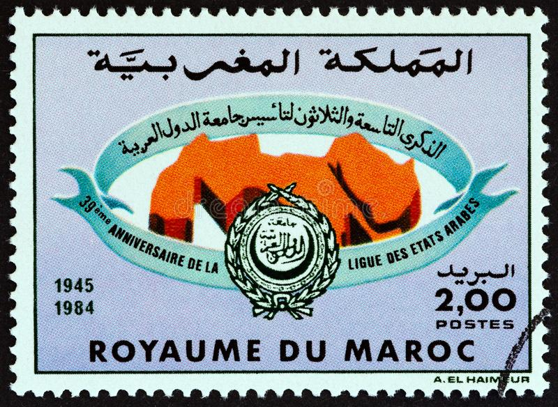 MOROCCO - CIRCA 1984: A stamp printed in Morocco issued for the 39th anniversary of Arab League shows emblem, circa 1984. stock photos