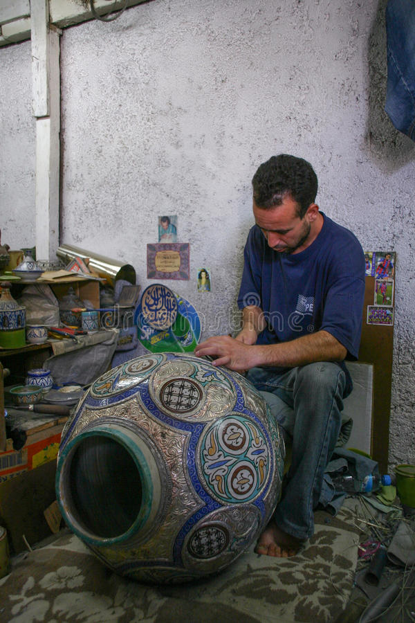 Morocco - Fez - decorator - Boy - draw - ceramic - pot royalty free stock image