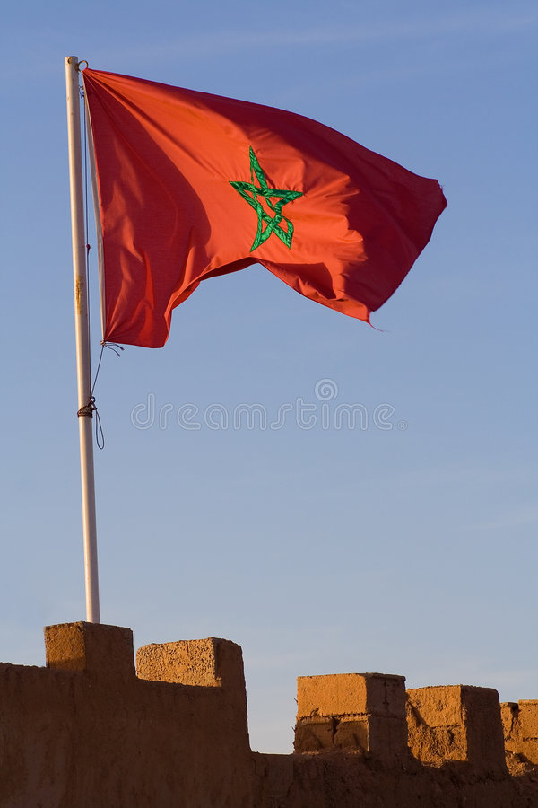 Morocco Flag on the City Wall. Sunset photo of a Morocco flag on the old city wall stock photography