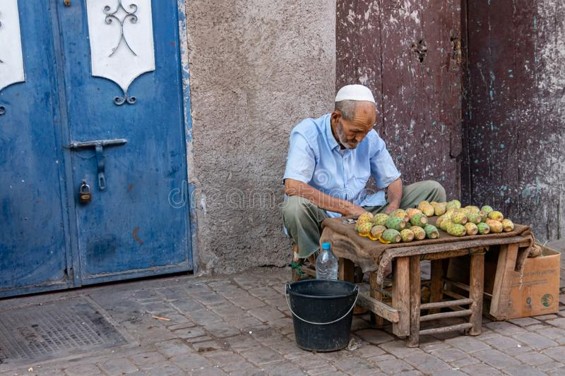 Morocco. Man selling prickly pears on a street in Marrakech, in October 2019 stock image