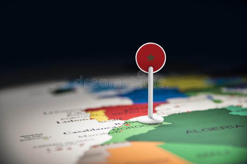 Morocco marked with a flag on the map royalty free stock photo