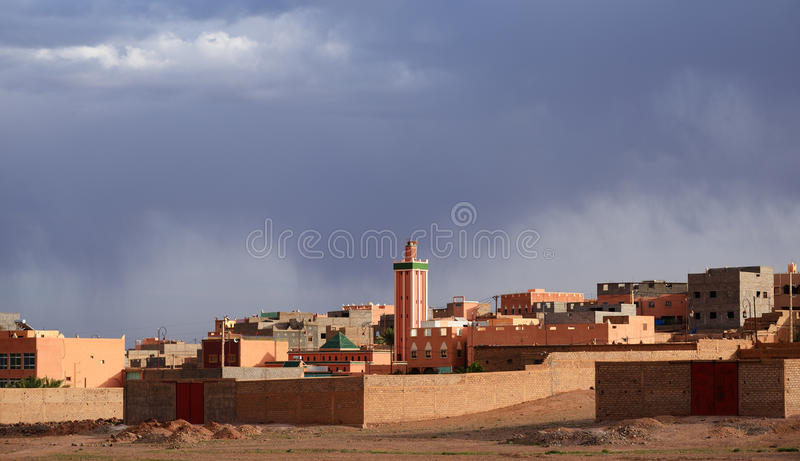 Morocco. Ouarzazate. City on the background of stormy clouds stock photos