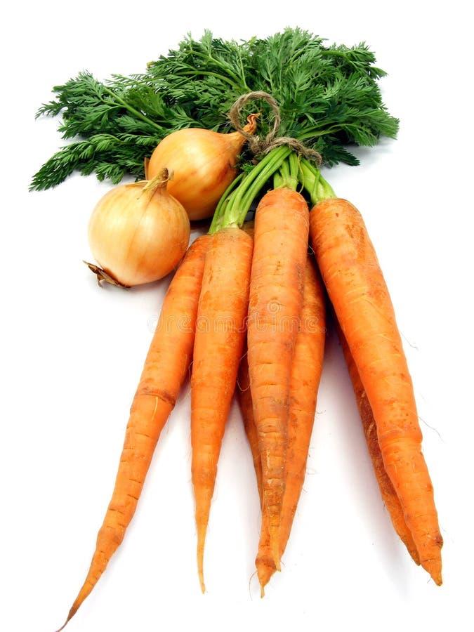 morotlökgrönsaker fotografering för bildbyråer