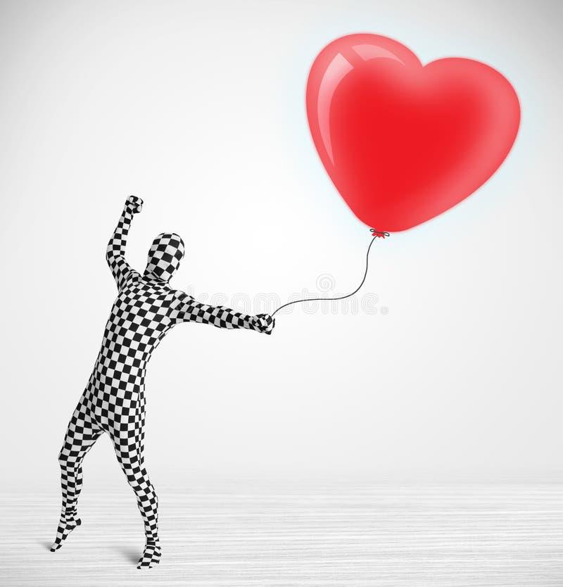 morpsuit看一个红色气球的身体衣服的人塑造了心脏 免版税库存图片