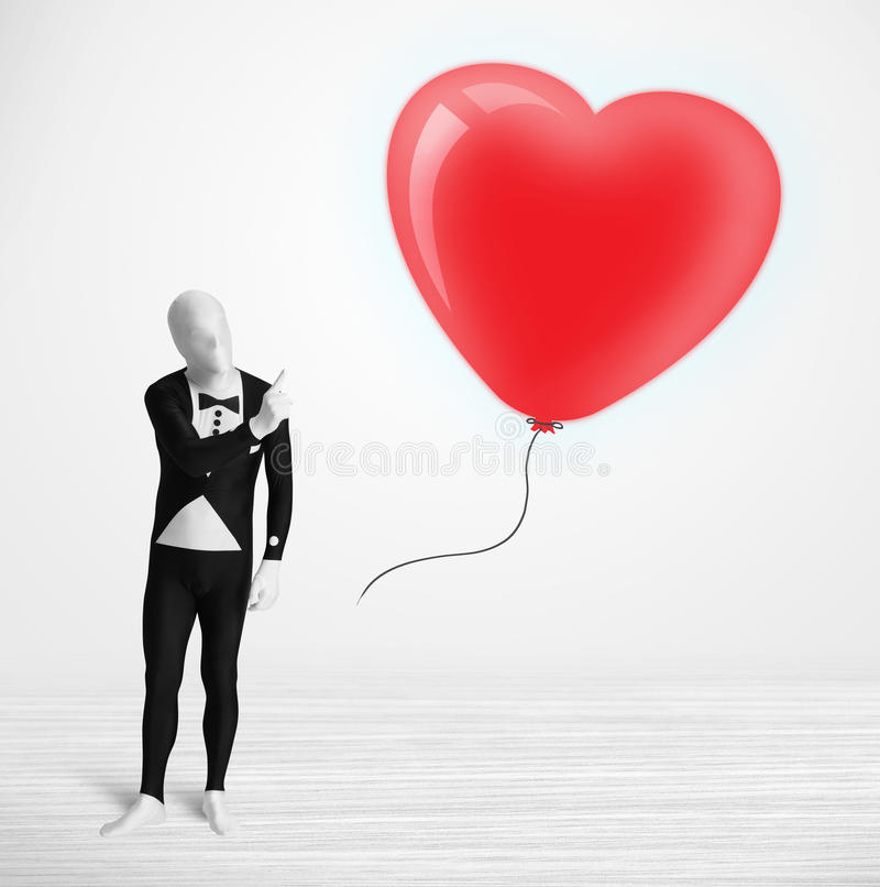 morpsuit看气球的身体衣服的人 免版税库存图片
