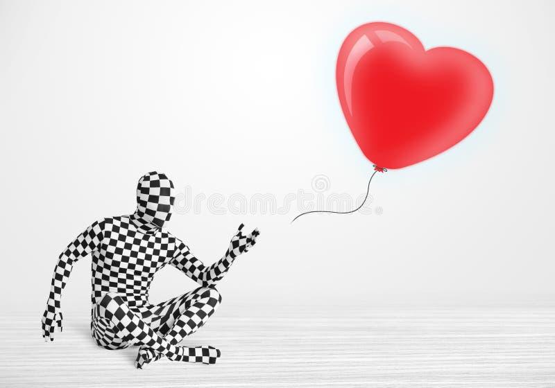 morpsuit看气球的身体衣服的逗人喜爱的人塑造了心脏 免版税图库摄影