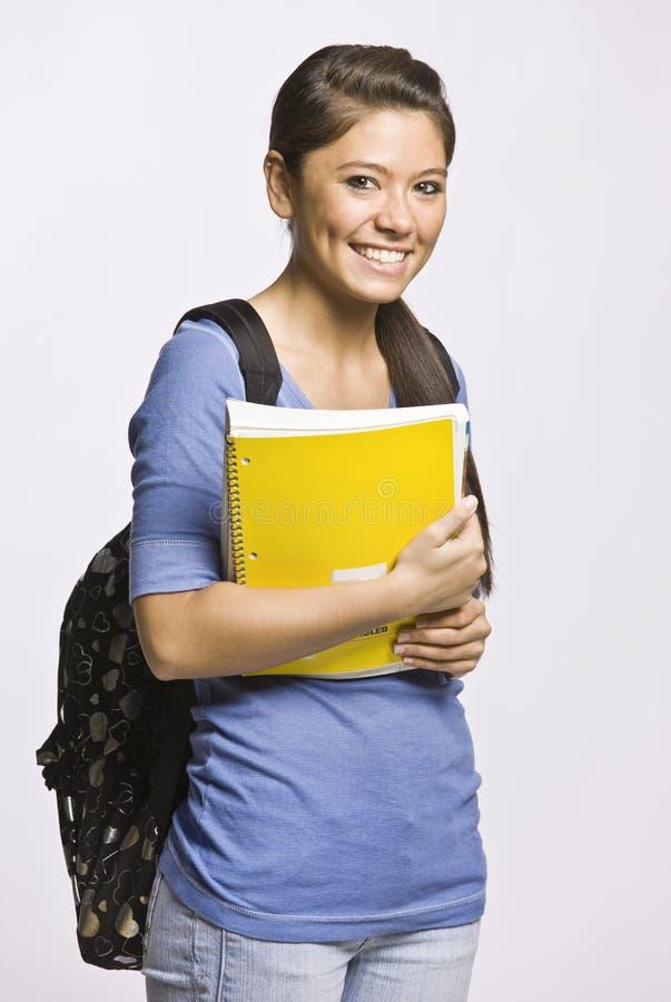 Morral y cuaderno que llevan del estudiante fotografía de archivo