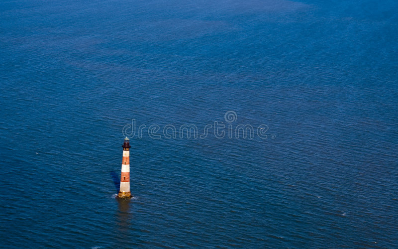 Morris Island Lighthouse. The Morris Island lighthouse, in Charleston, South Carolina. The image could be used to symbolize hope, isolation, or even rising ocean royalty free stock images