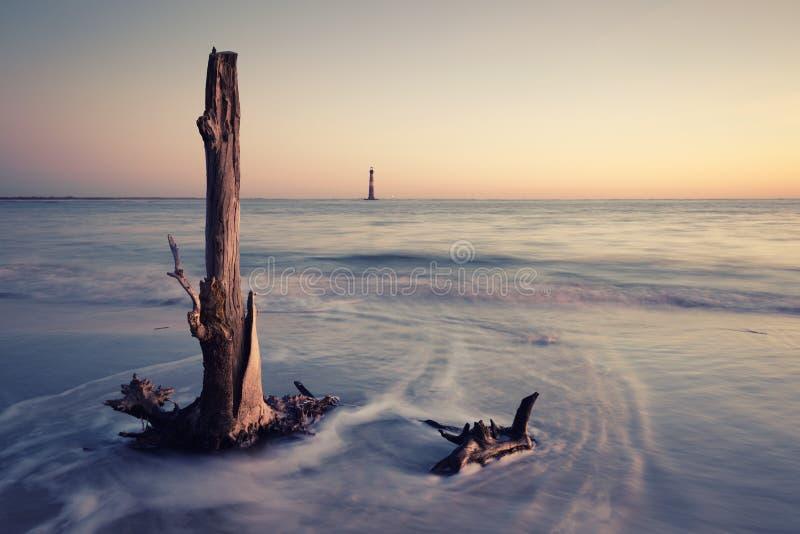 Morris Island Lighthouse en la salida del sol imagenes de archivo