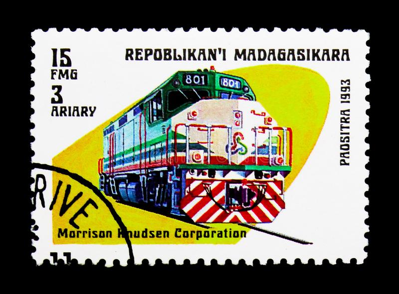 Morrison Knudsen Corporation train, Modern locomotives serie, ci. MOSCOW, RUSSIA - MARCH 18, 2018: A stamp printed in Madagascar shows Morrison Knudsen stock photography