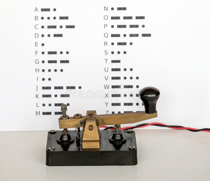 Morse Code. Key with  wall display in background stock photos
