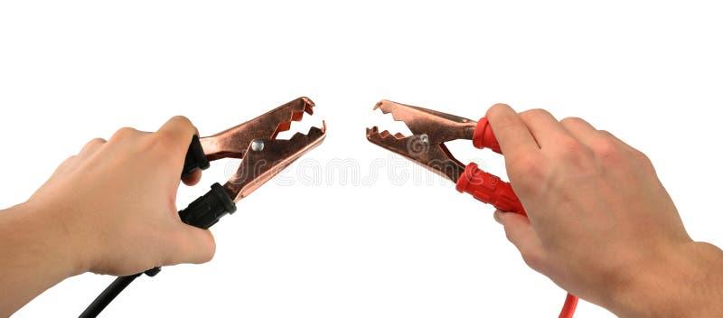 Morsetti della batteria isolati su un bianco fotografie stock libere da diritti