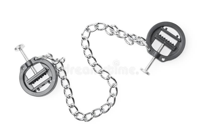 Morsetti neri del capezzolo del feticcio con la catena isolata su bianco immagini stock libere da diritti