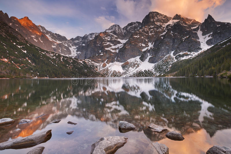 Morskie Oko lake in Poland at sunset. The Morskie Oko mountain lake in the Tatra Mountains in Poland, photographed at sunset stock images