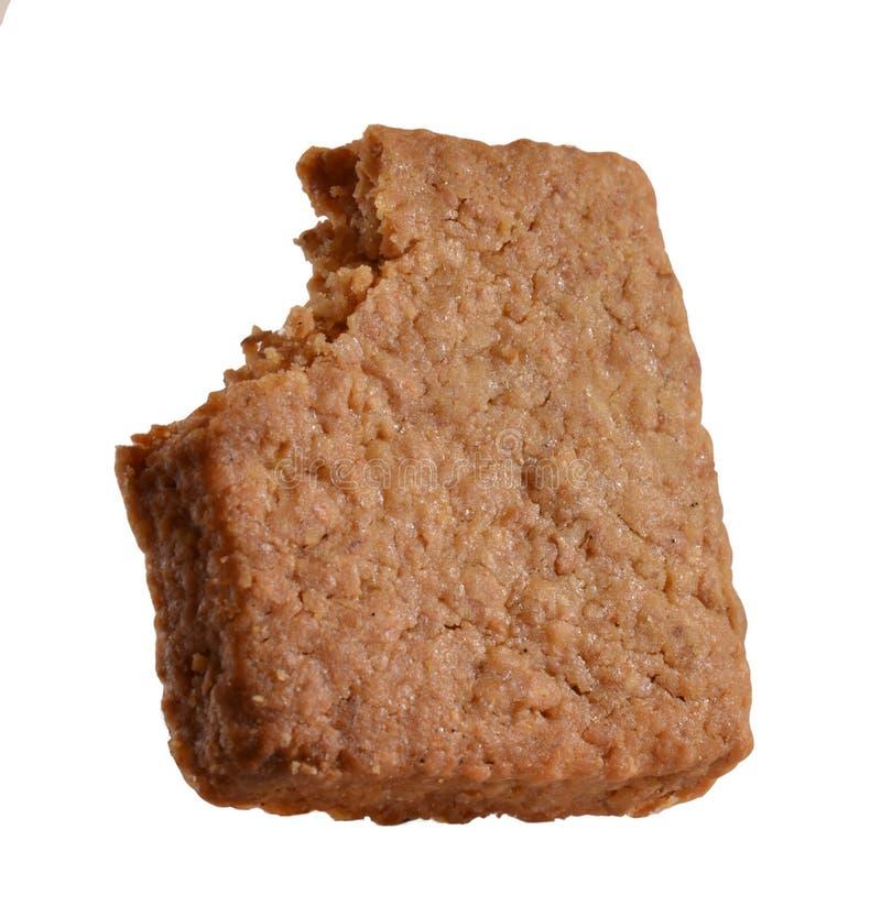 Morso del biscotto isolato immagini stock