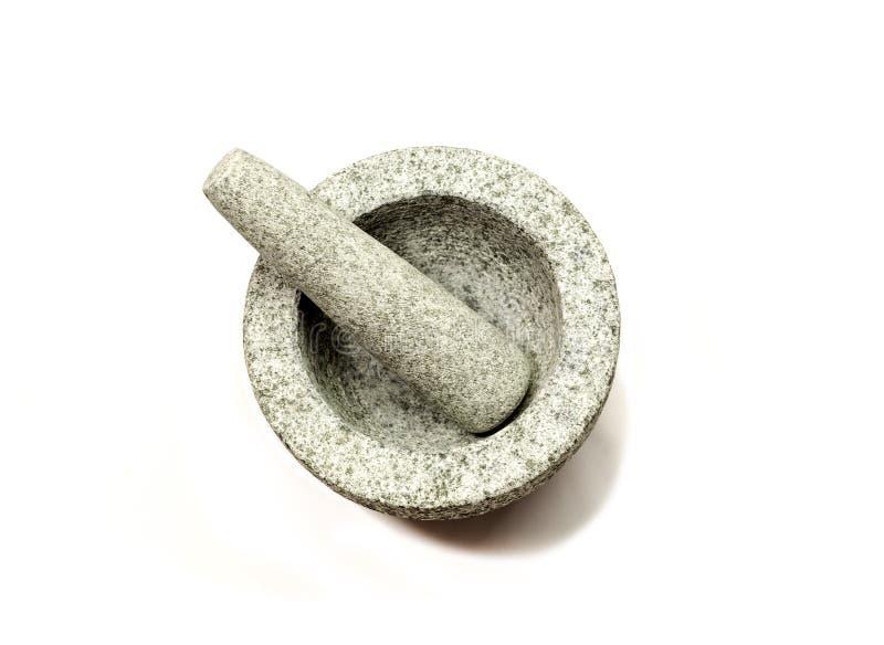 Mortaio di pietra con il pestello immagini stock