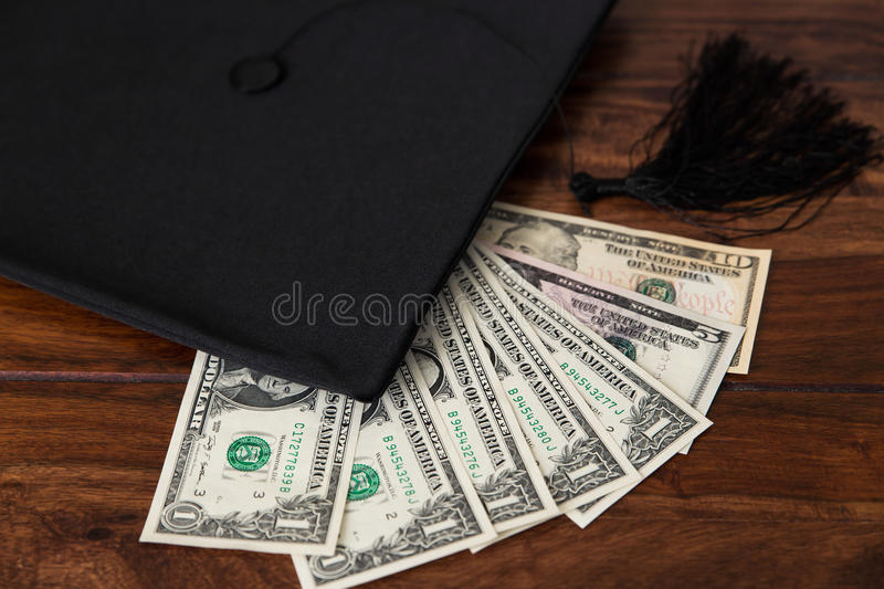 Mortar Board and dollar. S, concept tuition royalty free stock photo