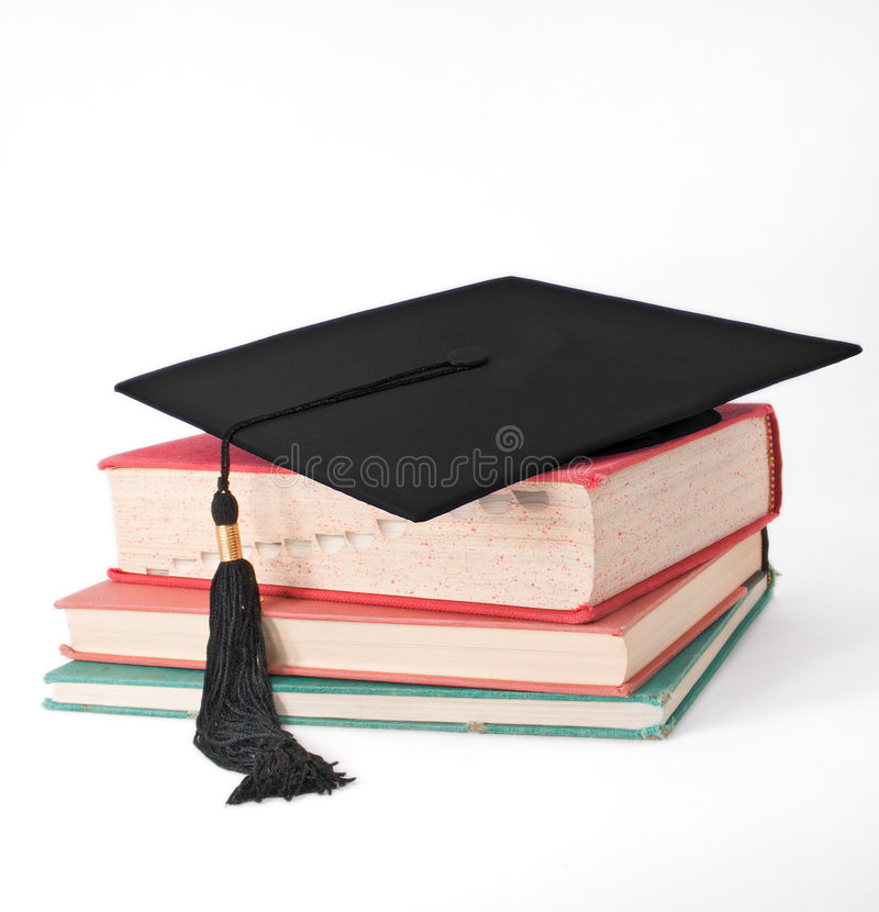 Download Mortar Board On Old Books Royalty Free Stock Image - Image: 2301926