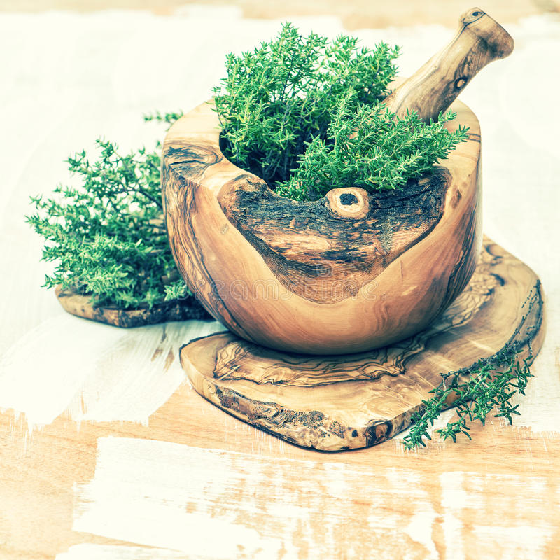 Mortar with fresh thyme herb. Healthy food ingredients. Vintage royalty free stock photos
