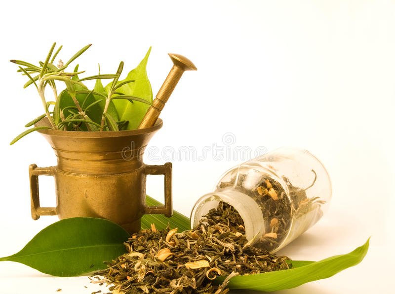 Mortar and glass, with herbal. stock image