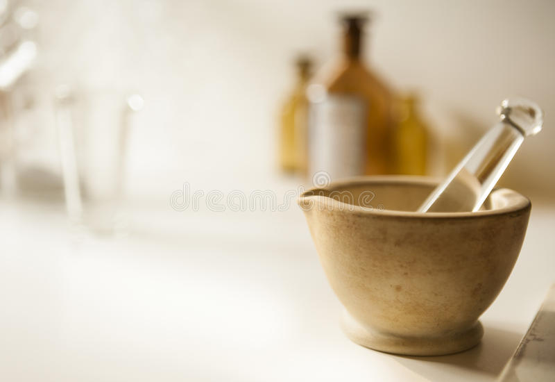 Mortar and pestle with drug vial and bottles stock images