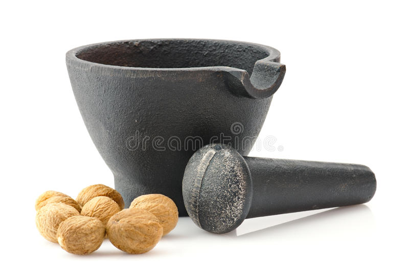 Download Mortar With Pestle And Nutmeg Royalty Free Stock Photos - Image: 16430138