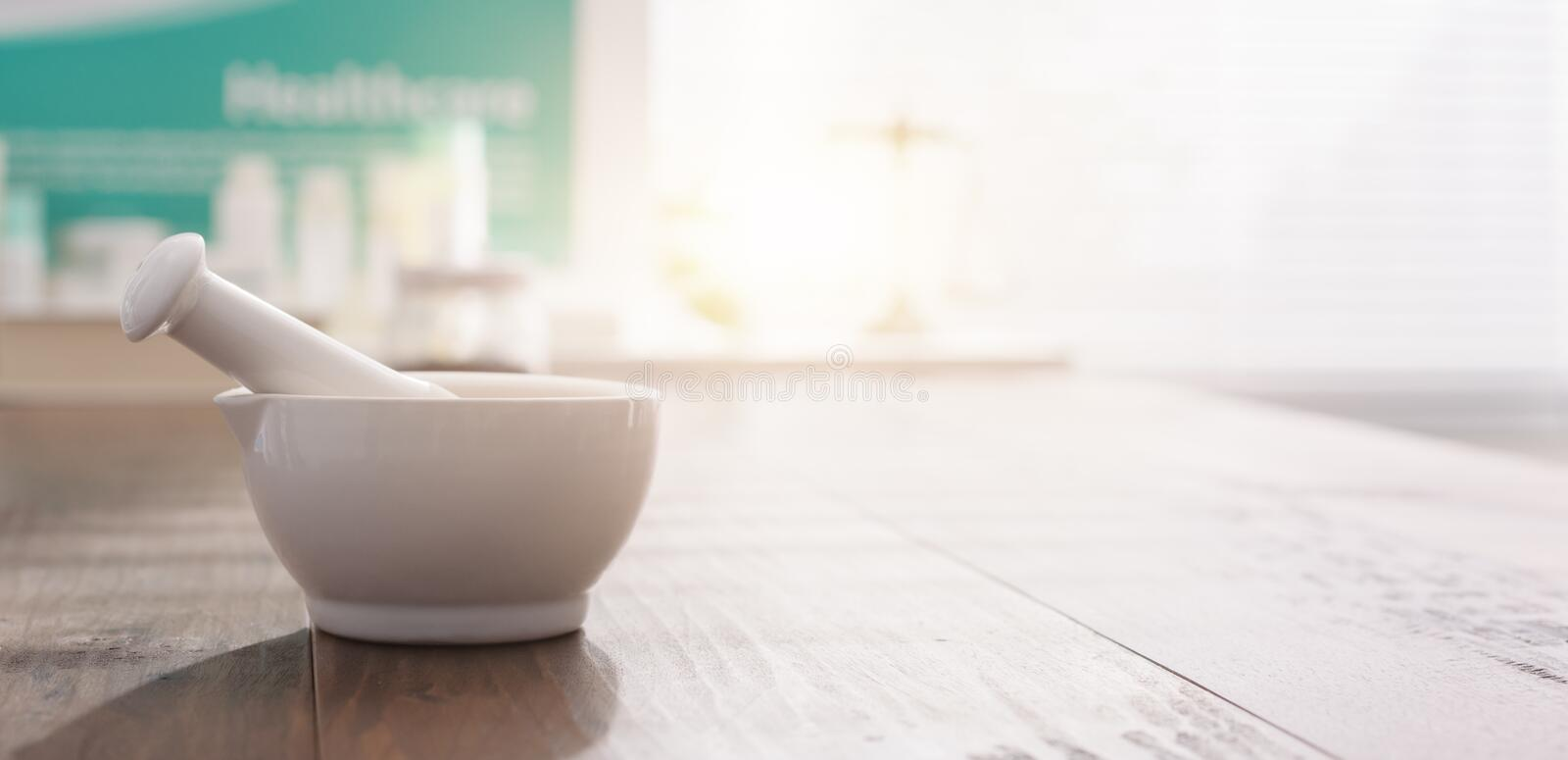 Mortar and pestle on the pharmacist`s table royalty free stock images