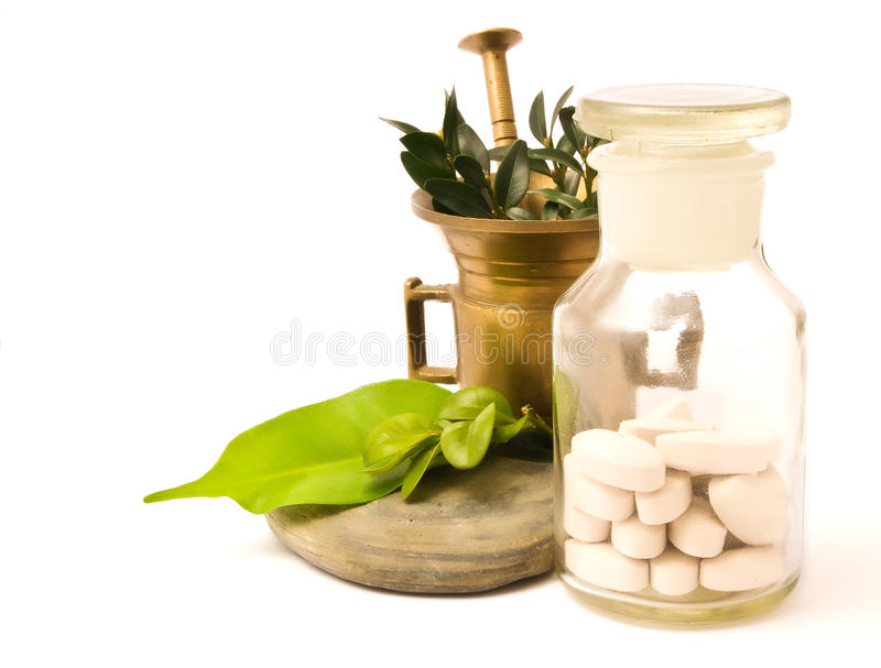 Download Mortar and pharmacy bottle stock photo. Image of leaves - 13445946