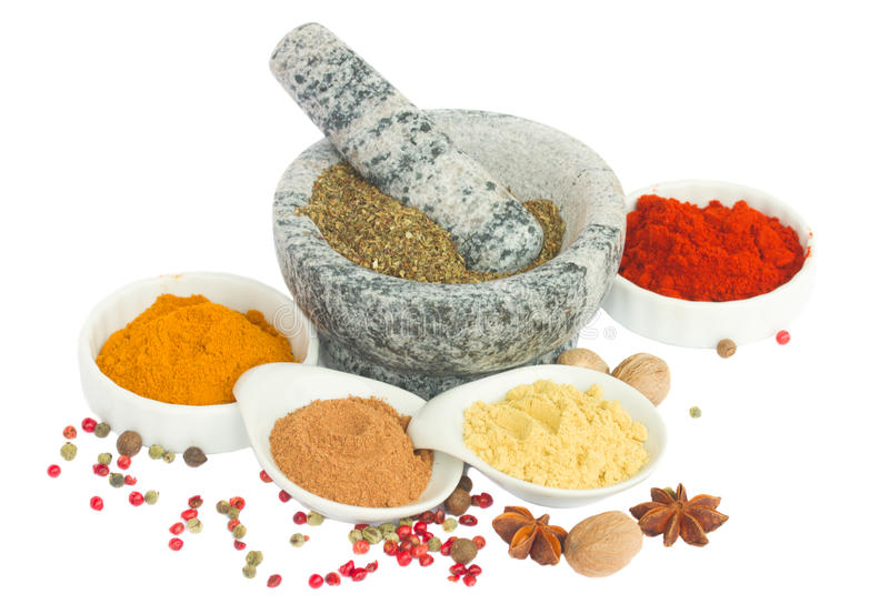 Mortar and plates of spices. Isolated on white royalty free stock images