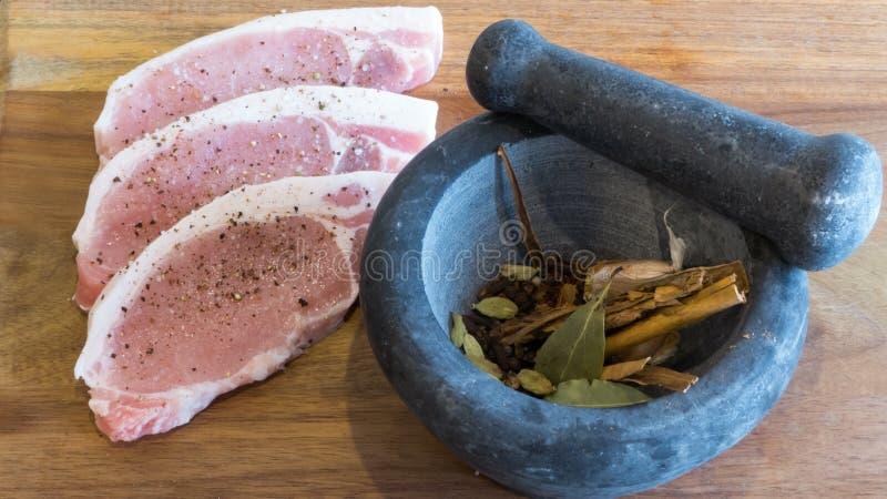 Mortar with pork chops stock photos