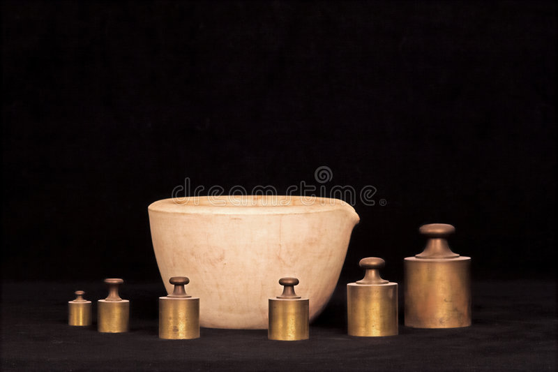 Mortar and weights royalty free stock photo