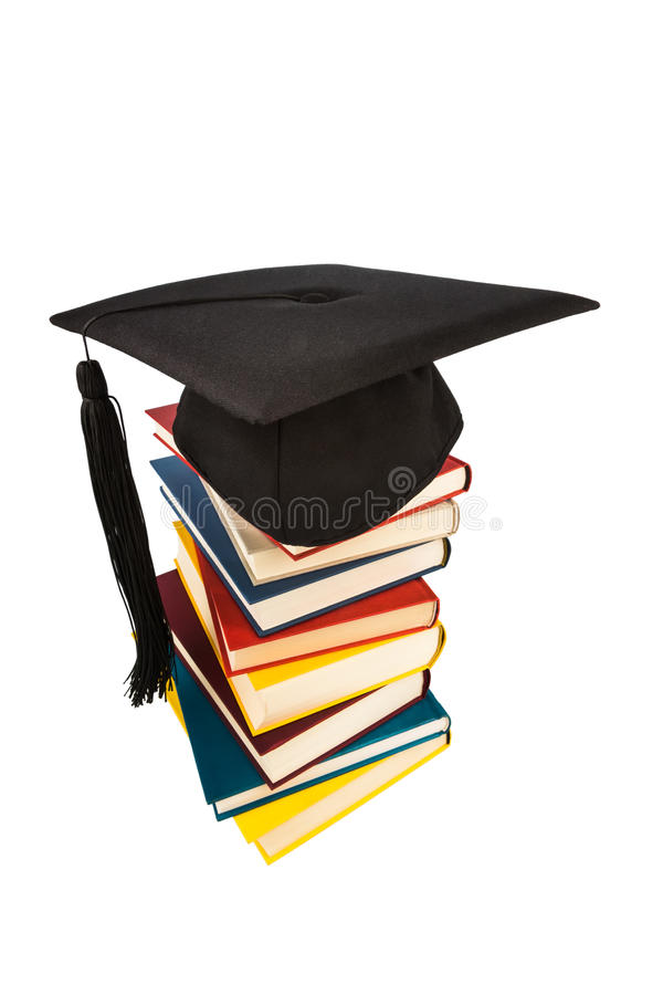 Mortarboard on books stack stock images