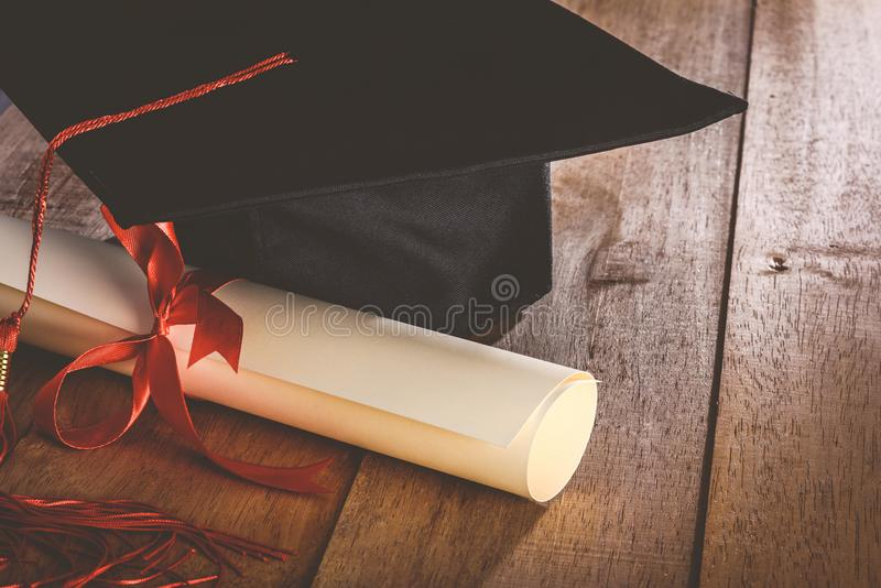 Mortarboard or graduation cap and diploma stock photography