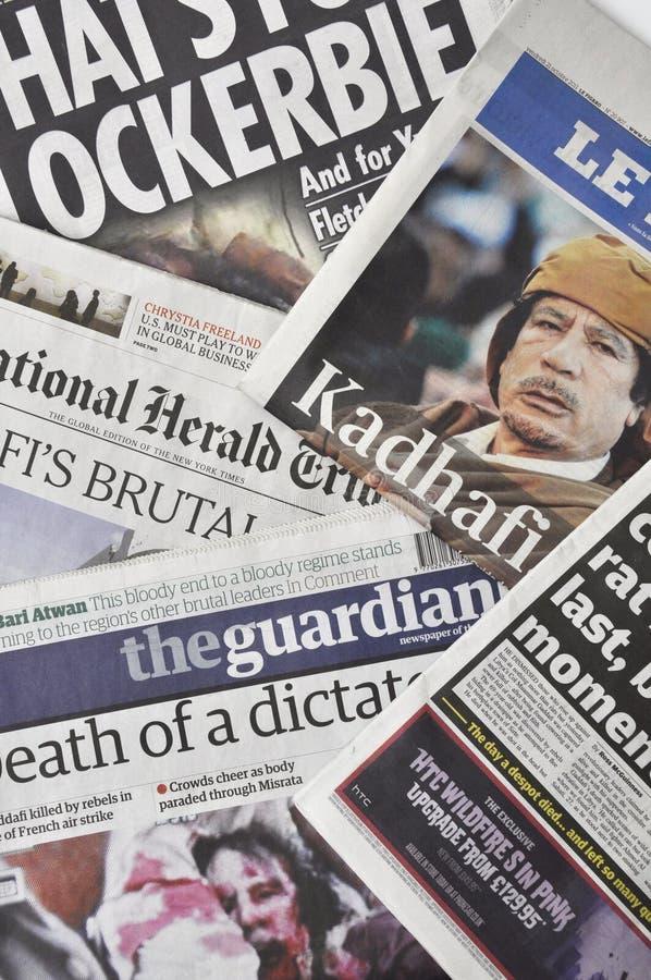 Morte del Gaddafi nella pressa fotografia stock libera da diritti