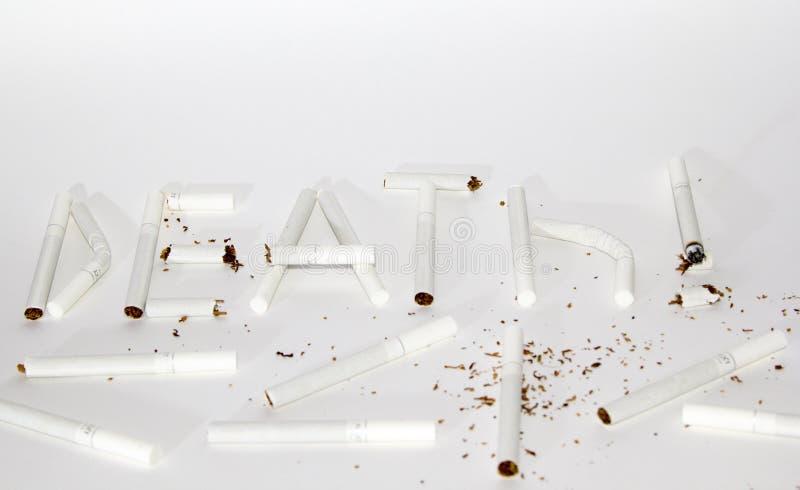 Morte dell'iscrizione dalle sigarette fotografie stock