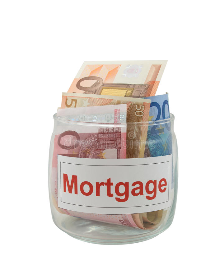 Mortgage. Conceptual photo of a mortgage. Euro banknotes in a glass jar isolated over white royalty free stock images