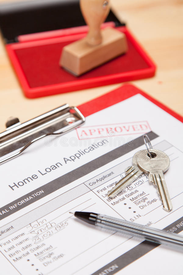 Mortgage application form. And keys royalty free stock photos