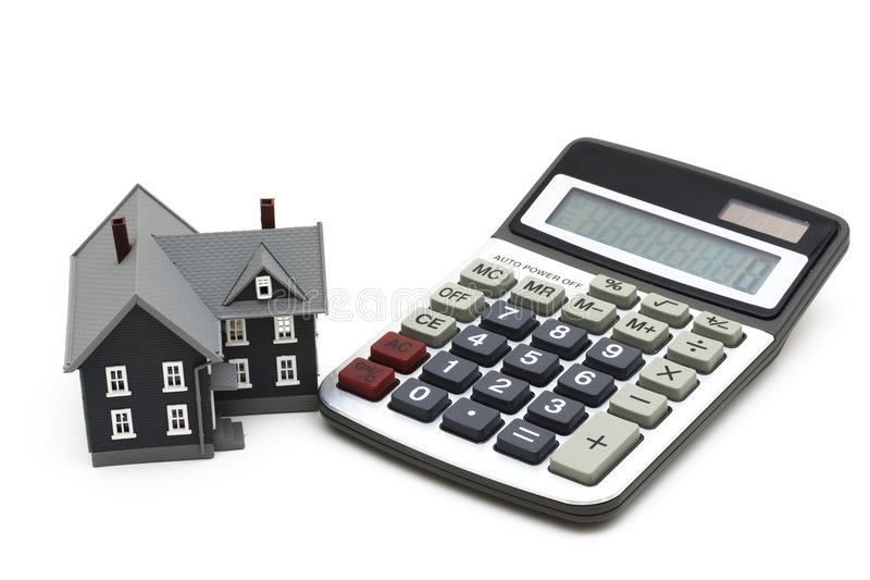 Mortgage Calculator. House and calculator isolated on a white background royalty free stock photography