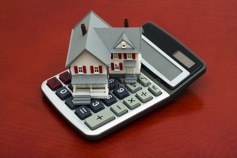 Mortgage Calculator. Model house sitting on a calculator ? calculating payments royalty free stock photography