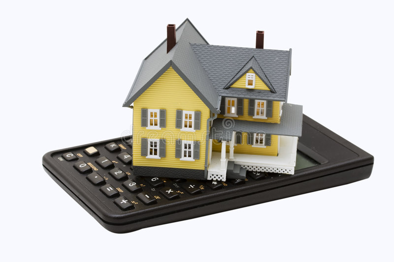 Mortgage Calculator. Model house sitting on calculator isolated on a white background stock photography