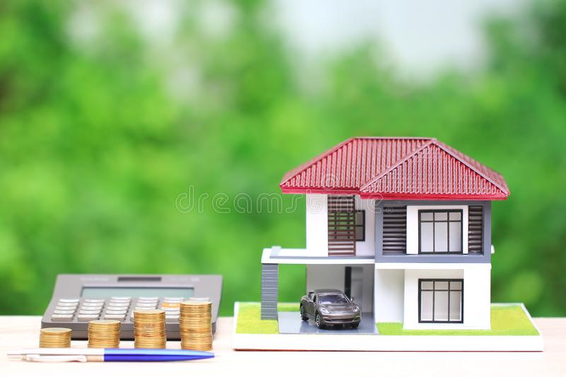 Mortgage calculator, Model house with Miniature car model green background, Interest rates and Real estate concept stock photos