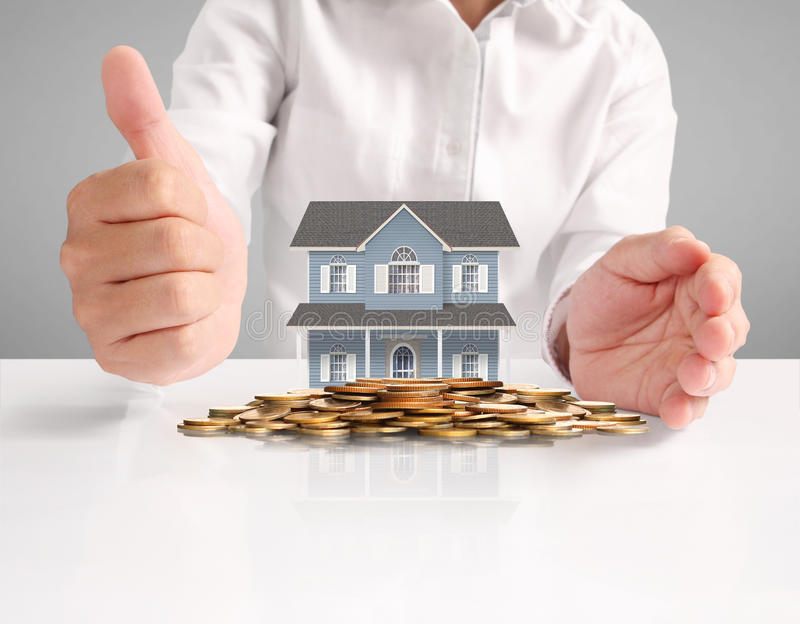 Mortgage concept by house from hand. Mortgage concept by house from in hand stock photos