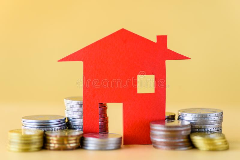 Mortgage concept by money house from the coins. stock photography