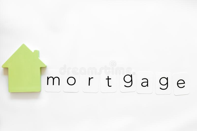 Mortgage copy with house figure on white background top view. Mortgage credit concept. Insurance copy with house figure on white background top view royalty free stock photos