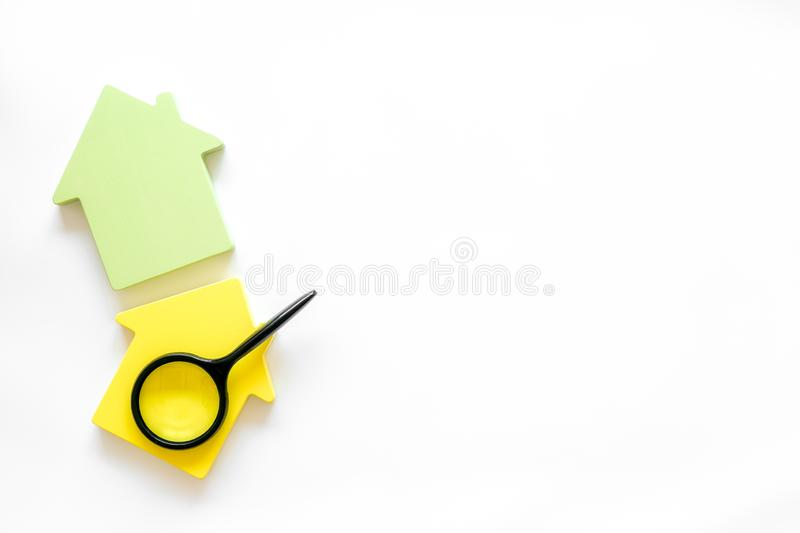 Mortgage credit concept with house toy and magnifier on white background top view copy space. Purchasing a new property on credit. Mortgage credit concept with royalty free stock images
