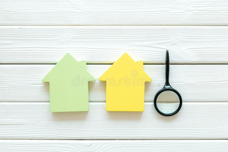 Mortgage credit concept with house toy and magnifier on white wooden background top view space for text. Purchasing a new property on credit. Mortgage credit stock images