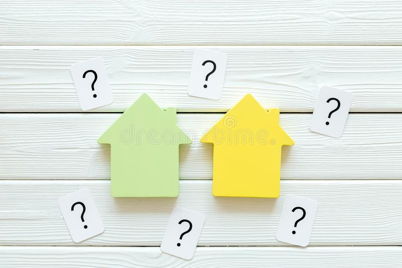 Mortgage credit concept with house toy and question mark on white wooden background top view space for text. Purchasing a new property on credit. Mortgage credit stock images