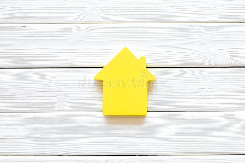 Mortgage credit concept with house toy on white wooden background top view space for text. Purchasing a new property on credit. Mortgage credit concept with stock photography